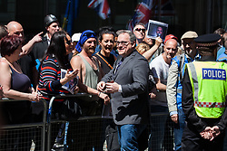 London, UK. 14 May, 2019. Ezra Levant joins supporters of Tommy Robinson outside the Old Bailey before the ex-English Defence League leader's appearance to face a hearing before two High Court judges for an allegation of contempt of court.