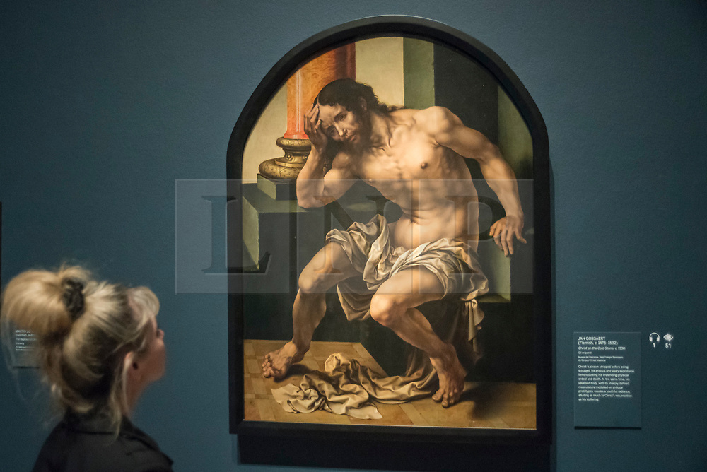 "© Licensed to London News Pictures. 28/02/2019. LONDON, UK. A visitor views ""Christ on the Cold Stone"" c1530 by Jan Gossaert. Preview of ""The Renaissance Nude"", an exhibition at the Royal Academy of Arts in Piccadilly of 90 works examining the emergence of the nude in European art.  Works by artists including Leonardo da Vinci to Michelangelo are on display in the Sackler Galleries 3 March to 2 June 2019.  Photo credit: Stephen Chung/LNP"