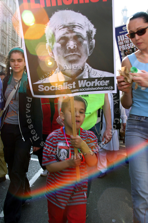 Child marching with an image of US President George W. Bush during an anti-war demonstration held in central London, UK, on Saturday, March 19, 2005. **ITALY OUT**