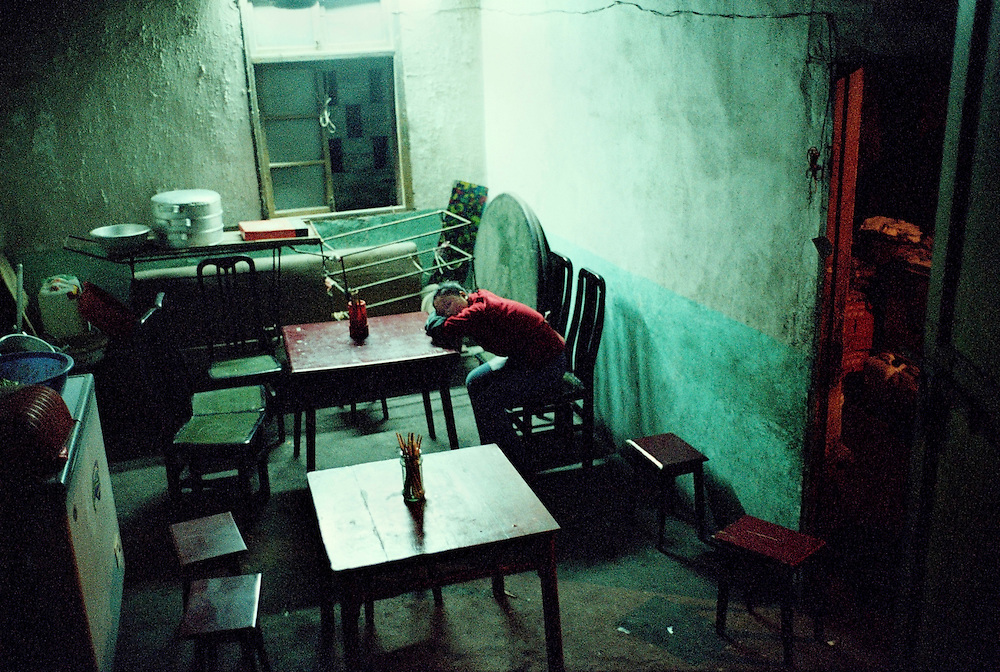 Last inhabitants. Business is very poor in the old cities where most of the local community has moved out. Badong, China. 2002