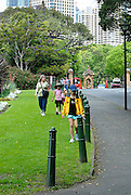 Mother and daughters (6 years old, 10 years old) strolling through The Domain, Sydney, Australia