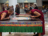 Tibetan Monks of the Drepung Loseling Monastery creating a Mandala Sand Painting by pouring millions of grains of colored sand from tradisional funnels called Chakpur. The finished Mandala will be approxiomately 5 x 5 feet in size and will take three to five days to finish - April 4-9, 2016 at the Wintergarden, Battery Park City.
