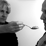 """Bob's daughter Ann feeds him lunch at his room in the assisted living home...ltqmb  """"daughter feed"""""""