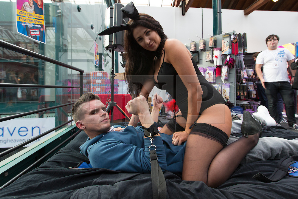 © London News Pictures. 26/10/2013 . London, UK. Gaz from Geordie Shore is seen strapped to a bed by a bunny girl at the Erotica show at Tobacco Dock in East London on 25 October 2013. The three day event runs from 25 October until 27 October and features stalls selling sex toys and clothes and stage shows of exotic dancing. Photo credit : Vickie Flores/LNP