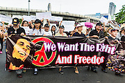 25 MAY 2014 - BANGKOK, THAILAND:  Protestors opposed to the military junta march around Victory Monument in Bangkok. Public opposition to the military coup in Thailand grew Sunday with thousands of protestors gathering at locations throughout Bangkok to call for a return of civilian rule and end to the military junta.    PHOTO BY JACK KURTZ