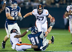 Connecticut linebacker C.J. Marck (31) holds up the football after intercepting a Virginia quarterback Scott Deke (15) pass.  The Connecticut Huskies defeated the Virginia Cavaliers 45-10 in NCAA football at Rentschler Field in East Hartford, CT on September 13, 2008.