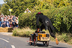 Cookham Dean, UK. 1 September, 2019. A custom-built kart in the form of Chitty Chitty Bang Bang is restarted following a crash during the Cookham Dean Gravity Grand Prix in aid of the Thames Valley and Chiltern Air Ambulance.