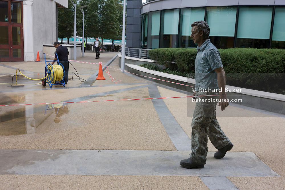 Maintenance work is carried out in a London estate with statue artwork taped-off.