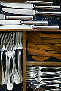 Berkeley, California, 2008-Spoons, knives and forks resting in a kitchen drawer.