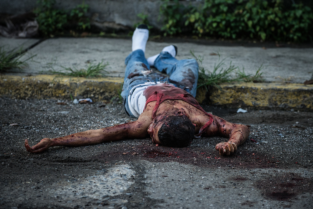 EL LLANITO, VENEZUELA - NOVEMBER 20, 2016:  An unidentified murder victim, shot multiple times.  Caracas has one of the highest homicide rates in the world, and over 95% (CK) of cases are never resolved.  PHOTO: Meridith Kohut for The New York Times
