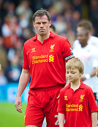 12.05.2013, Craven Cottage, London, ENG, Premier League, FC Fulham vs FC Liverpool, 37. Runde, im Bild Liverpool's captain Jamie Carragher leads his side out to face Fulham during during the English Premier League 37th round match between Fulham FC and Liverpool FC at the Craven Cottage, London, Great Britain on 2013/05/12. EXPA Pictures © 2013, PhotoCredit: EXPA/ Propagandaphoto/ David Rawcliffe..***** ATTENTION - OUT OF ENG, GBR, UK *****