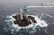 IRELAND, Fastnet Rock. 2nd July 2012. Volvo Ocean Race, Leg 9, Lorient to Galway. Camper with Emirates Team New Zealand (right) and Groupama Sailing Team approach the Fastnet Rock.