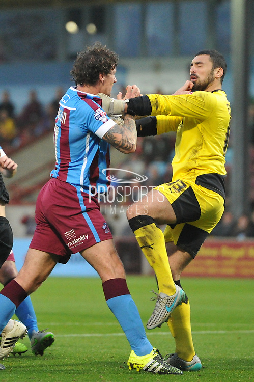Joe Anyon of Scunthorpe United in scuffle with Nick Townsend of Barnsley FC during the Sky Bet League 1 match between Scunthorpe United and Barnsley at Glanford Park, Scunthorpe, England on 31 October 2015. Photo by Ian Lyall.