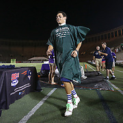 Brent Adams #28 of the Boston Cannons goes up to receive an award after getting his head shaved for charity following the game at Harvard Stadium on August 9, 2014 in Boston, Massachusetts. (Photo by Elan Kawesch)