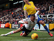 Ashley Richards getting fouled during the Sky Bet Championship match between Fulham and Derby County at Craven Cottage, London, England on 28 February 2015. Photo by Matthew Redman.