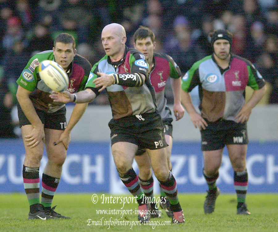 Photo. Peter Spurrier.Parker Pen Challenge Cup 17/01/2004 Harlequins v Montauban.Paul Burke, look's for players to distribute the ball to..left to right behind Tony Diprose, James Hayter and Mke Worsley.   [Mandatory Credit, Peter Spurier/ Intersport Images].