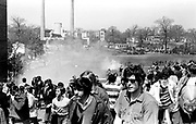 705/4-2 (7/7A)...  Students move away fromt the commons as the Guard fire tear gas, May 4, 1970.