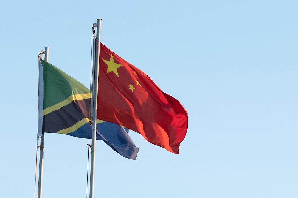 Dar es Salaam, Tanzania  - 12/17/16 - Tanzania and China flags fly from in Dar es Salaam on December 17, 2016.   Photo by Daniel Hayduk