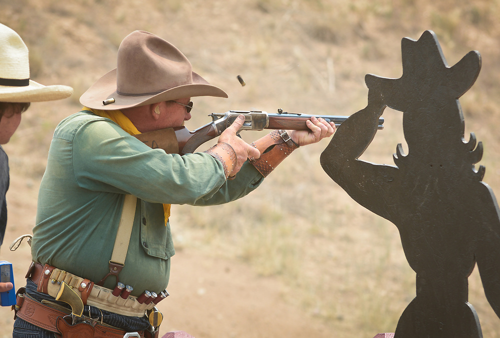 mkb062417h/metro/Marla Brose --  Mike Moniot of Portales fires a rifle with shells flying while competing in one stage of The World Championship of Cowboy Action Shooting, Saturday, June 23, 2017, at Founders Ranch in Edgewood,  N.M. About 600 shooters, all dressed in Old West-era attire, brought their pistols, rifles and shotguns to compete in the 36th annual shooting event at  Founders Ranch in Edgewood, N.M.  The public was welcome to watch on Friday and Saturday. The event ends on Sunday, a day which is closed to the public. (Marla Brose/Albuquerque Journal)
