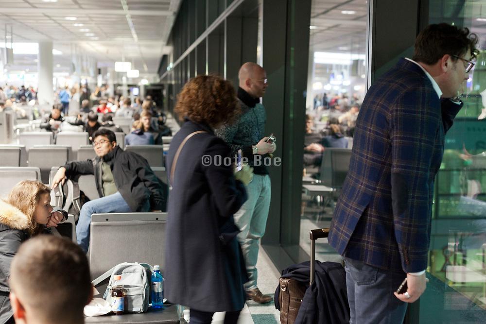 departure terminal with people waiting Frankfurt airport