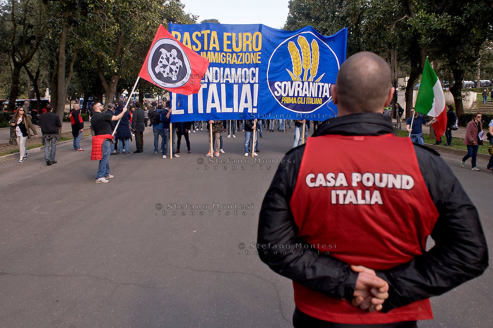 "Roma 28 Febbraio 2015<br /> ""Renzi a casa!' - Il corteo di Casapound  movimento di estrema destra, che partecipa alla manifestazione della Lega nord contro il il presidente del Consiglio Matteo Renzi.<br /> Rome February 28, 2015<br /> ""Renzi at home! '- The manifestation of  Casapound, far-right movement, participating in the demonstration of the Northern League against the Prime Minister Matteo Renzi."