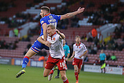 Oldham Athletic forward Jake Cassidy  battles with Sheffield United defender James McEveley  during the The FA Cup match between Sheffield Utd and Oldham Athletic at Bramall Lane, Sheffield, England on 5 December 2015. Photo by Simon Davies.