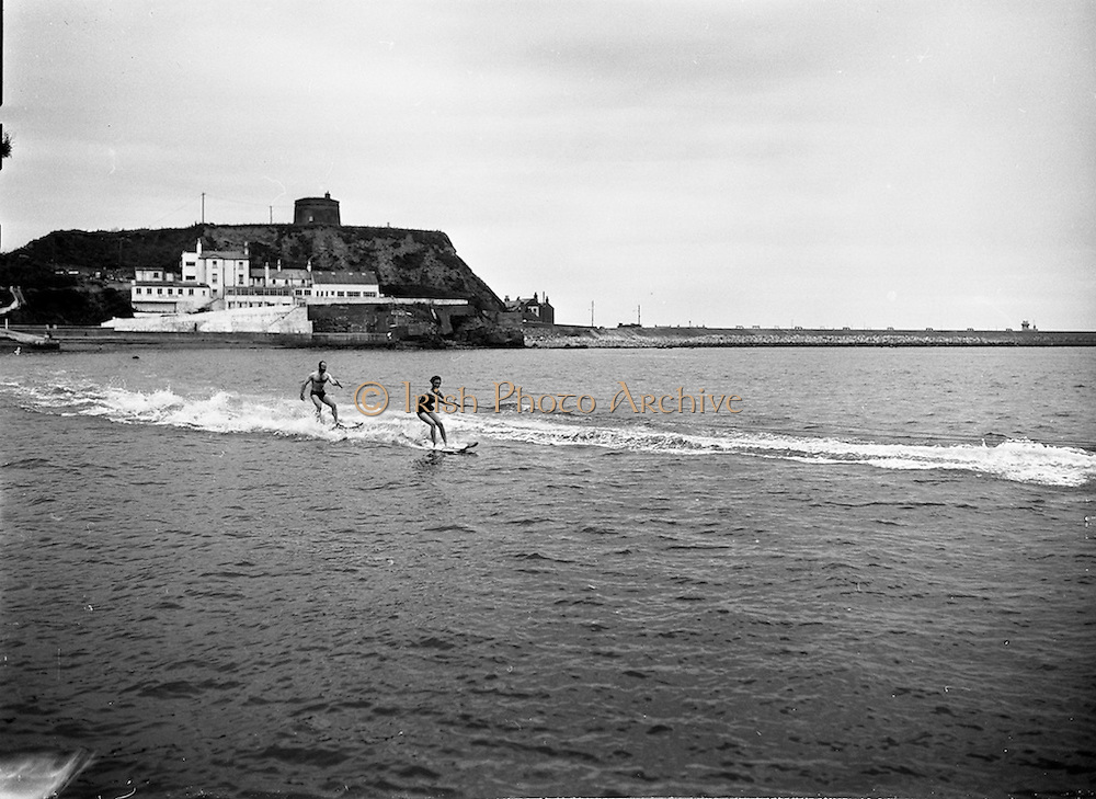 23/06/1959<br /> 06/23/1959<br /> 23 June 1959<br /> Water skiing at Balscadden Bay, Howth, Dublin. Mr and Mrs Carr. In the background is the Cliff Hotel and Martello Tower.
