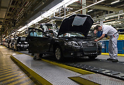 BRUSSELS, BELGIUM - MAY-30-2007 - Workers assemble an Audi A3 on the production line at the Audi factory in Brussels, Belgium, Thursday, May 30, 2007. Audi AG, Volkswagen AG's luxury division, took control of the namesake brand's Brussels factory today to add capacity for building the new A1 small car. VW's will be produced until the end of the year at the Brussels factory.(PHOTO © JOCK FISTICK)