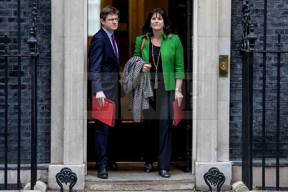 © Licensed to London News Pictures. 12/03/2019. London, UK. Secretary of State for Business, Energy and Industrial Strategy Greg Clark (L) and Minister of State at Department for Business, Energy and Industrial Strategy Claire Perry (R) leave 10 Downing Street after the Cabinet meeting. MPs will get a second meaningful vote on Prime Minister Theresa May's Brexit deal this evening. Photo credit: Rob Pinney/LNP