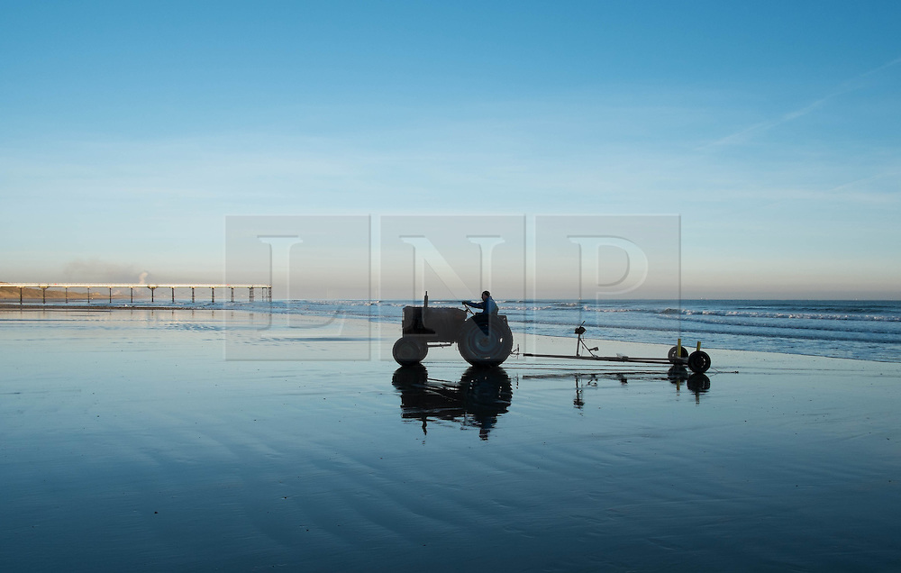 © Licensed to London News Pictures. 11/03/2014<br /> <br /> Saltburn by the Sea, England<br /> <br /> A local fishermen drives his tractor back up the beach after launching his boat at first light in Saltburn by the Sea in Cleveland.<br /> <br /> Photo credit : Ian Forsyth/LNP