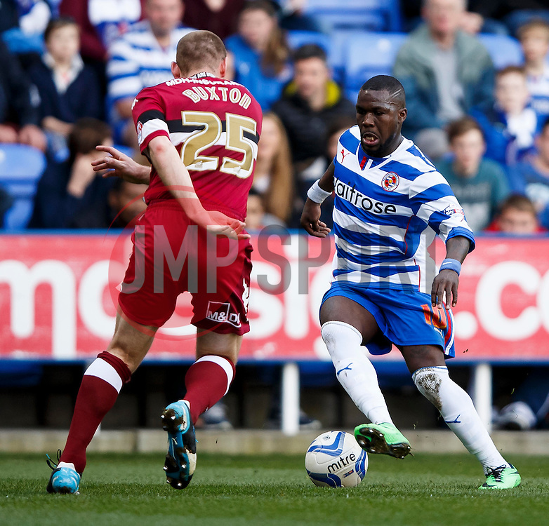 Reading Defender Royston Drenthe (NED) is challenged by Derby Defender Jake Buxton (ENG) - Photo mandatory by-line: Rogan Thompson/JMP - 07966 386802 - 15/09/2014 - SPORT - FOOTBALL - Madejski Stadium - Reading - Reading v Derby County - Sky Bet Football League Championship.
