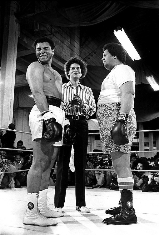 Muhammad Ali faces off against Atlanta (GA) Mayor Maynard Jackson in a charity fundraiser in Atlanta, GA in 1973. Officiating (middle) is Julian Bond, then President of the Southern Christian Leadership Council (SCLC).