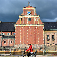 Cyclist in Front of Holmens Kirke in Copenhagen, Denmark <br />