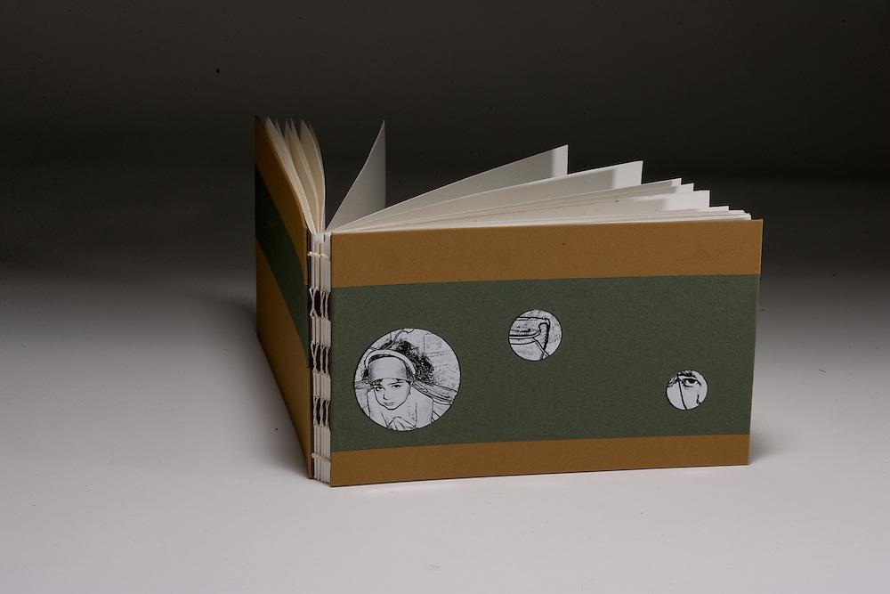 Sketchbook sewn on tapes.