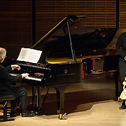 May 5, 2012 - New York, NY : Puppeteers Ursula Winzer, second from right, and Vladimir Fediakov, far right, of the Salzburg Marionette Theater perform Claude Debussy's 'La boîte à joujoux (The Toy Box) (1913),' featuring pianist András Schiff, second from left, at Zankel Hall on Saturday evening. CREDIT: Karsten Moran for The New York Times