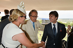 Left to right, ZARA TINDALL, the EARL OF MARCH and TOM CRUISE at the 2014 Glorious Goodwood Racing Festival at Goodwood racecourse, West Sussex on 31st July 2014.