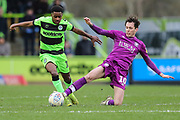 Forest Green Rovers Reece Brown(10) rides a challenge from Carlisle United's Jamie Devitt(10) during the EFL Sky Bet League 2 match between Forest Green Rovers and Carlisle United at the New Lawn, Forest Green, United Kingdom on 16 March 2019.