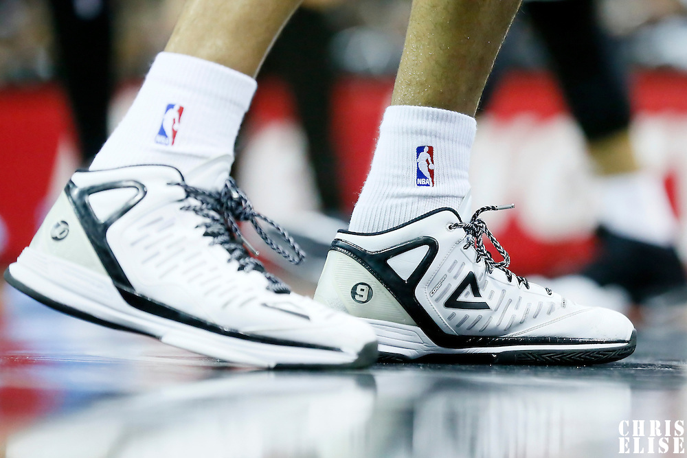 03 April 2015: San Antonio Spurs guard Tony Parker (9) Peak shoes are seen during the San Antonio Spurs 123-93 victory over the Denver Nuggets , at the AT&T Center, San Antonio, Texas, USA.