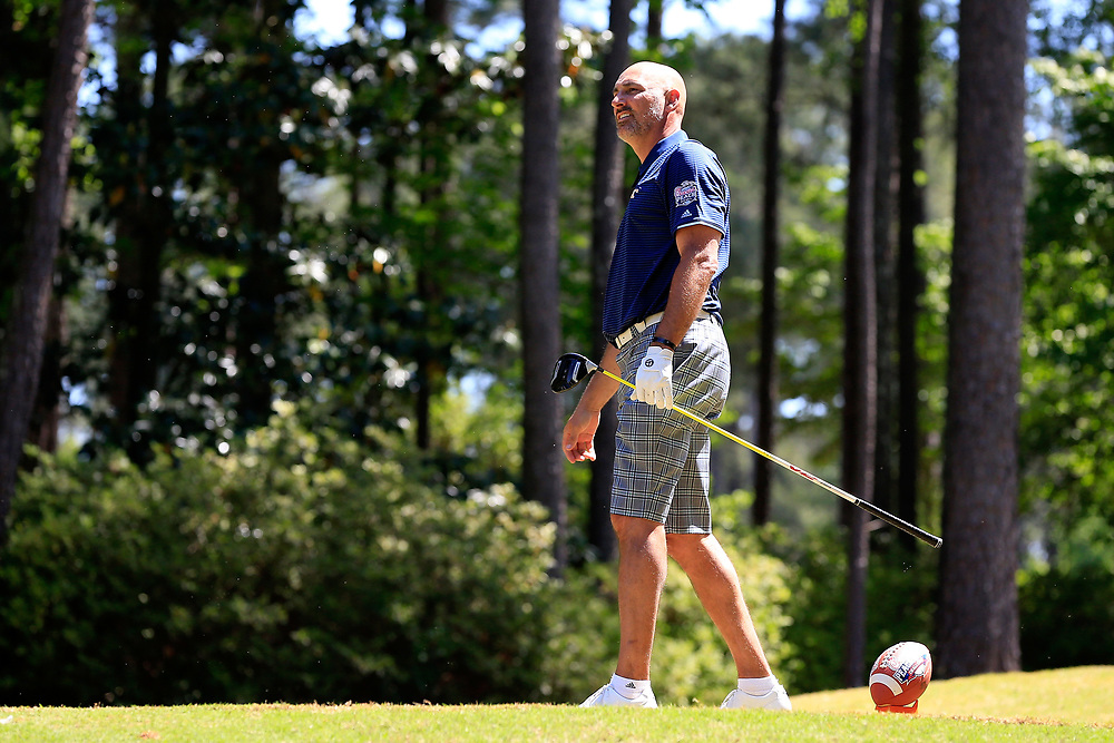 Jon Barry tees off during the Chick-fil-A Peach Bowl Challenge at the Oconee Golf Course at Reynolds Plantation, Sunday, May 1, 2018, in Greensboro, Georgia. (Paul Abell via Abell Images for Chick-fil-A Peach Bowl Challenge)