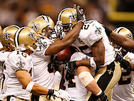 Reggie Bush (25) is congratulated by teammates on his fourth quarter touchdown on a 65-yard punt return. BRENDAN FITTERER | Times STORY SUMMARY Tampa Bay Buccaneers at New Orleans Saints Sunday (10/8/06) at the Louisiana Superdome