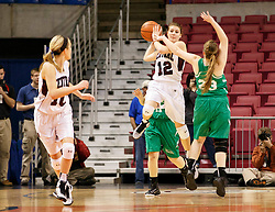 Wheeling Central's Lindsey Baker (12) passes down court to Wheeling Central's Regan Blaha (10) during a first round game at the Charleston Civic Center.