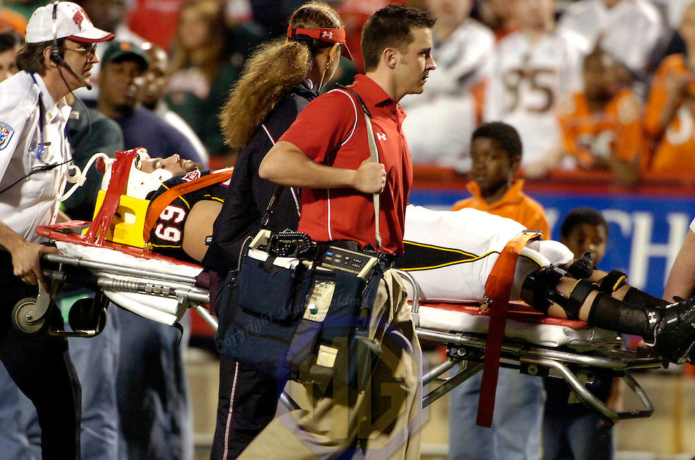 11 November 2006:   The University of Maryland's Donnie Woods (69) is taken off the field on a stretcher in the third quarter after being injured against the Miami University Hurricanes  Woods was medavaced to a hospital for treatment.  The Maryland Terrapins defeated the Miami University Hurricanes 14-13 at Byrd Stadium in College Park, Maryland.<br />