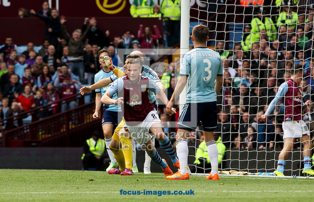 Tom Cleverley (centre) of Aston Villa celebrates scoring his sides first goal during the Barclays Premier League match at Villa Park, Birmingham<br /> Picture by Tom Smith/Focus Images Ltd 07545141164<br /> 09/05/2015