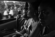 Zanzibar Town, Zanzibar -   2015-03-27  - Recovering addicts, including Sandra at left and Hadidja at right, get a ride to an NA meeting in Stone Town, Zanzibar on March 27, 2015.  Photo by Daniel Hayduk