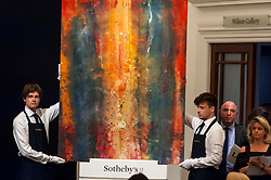 © Licensed to London News Pictures. 26/06/2018. LONDON, UK. ''Forth'' by Sam Gilliam, (Est. £400,000 - 600,000) sold for a hammer price of £750,000 at Sotheby's Contemporary art evening sale in New Bond Street.  Photo credit: Stephen Chung/LNP
