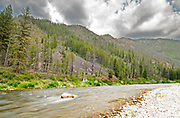 Storm clouds and soft water at Sheepeater Camp, Middle Fork of the Salmon River, Idaho.