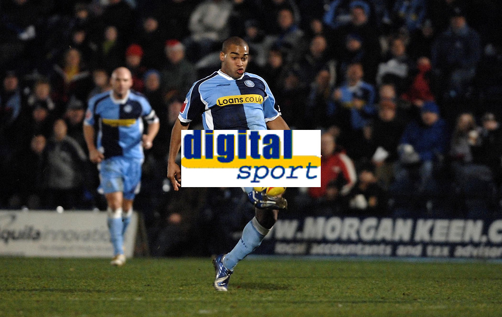 Photo: Richard Lane.<br />Wycombe Wanderers v Stockport County. Coca Cola League 2. 23/12/2006. <br />Wycombe's Jermaine Easter hits the ball to score a goal.