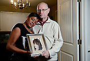 From left: Tracy B-Wilson and her husband Mark Wilson hold a photo of Brooke Brunsvold, Thursday, Dec. 18, 2014, at their home in Lafayette. Brunsvold, a Centaurus High School junior, was struck and killed by a car on U.S. 287 in Lafayette on Monday, Sept. 10, 2012. Go to dailycamera.com for more photos and video.<br /> (Matthew Jonas/Longmont Times-Call)