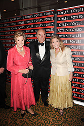Left to right, DAME NORMA MAJOR, CHRISTOPHER FOYLE and his wife CATHERINE FOYLE at a gala dinner in celebration of 80 years since the first Foyles Literary Luncheon, held in The Ball Room, Grosvenor House Hotel, Park Lane, London on 21st October 2010.