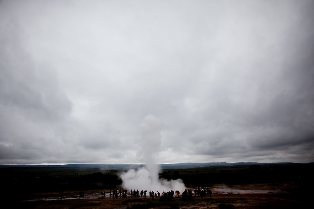 "A geyser named ""Strokkur"" erupts in the Haukadalur region, Iceland."